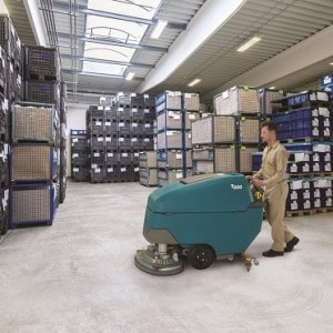 Horizontal image of modern new warehouse/factory. The warehouse is filled with boxes on pallets. Logistics, freight, shipping, receiving. No people, space for copy.